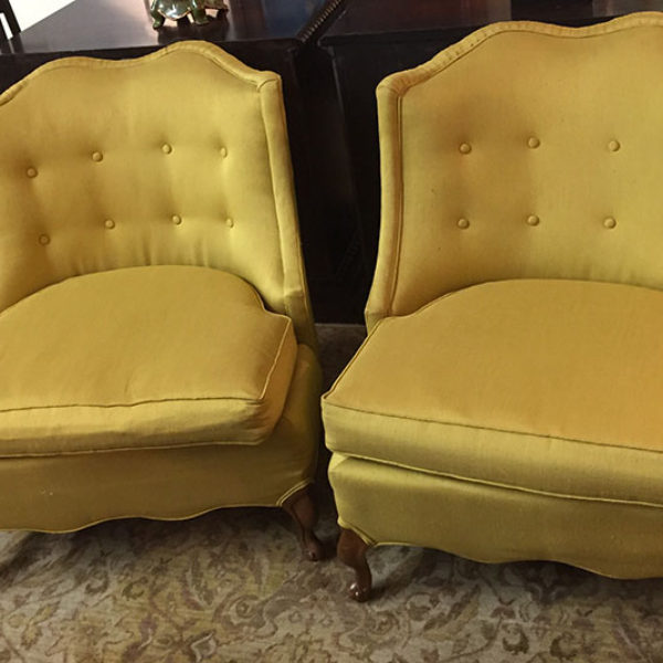 pair gold silk armless lounge chairs